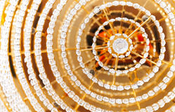 Abstract colorful background with crystal elements. Abstract colorful background with crystal glass design elements of round vintage chandelier Stock Photo