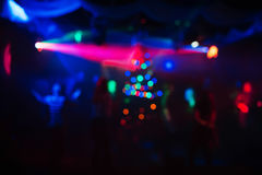 Abstract colorful background in night club with soft lasers and the lights from the Christmas tree Stock Photo
