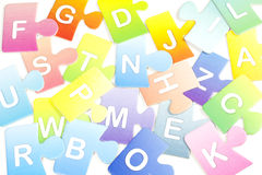 Abstract colorful background with puzzle letters Stock Photography