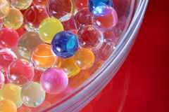 Abstract colorful balls in glass bawl. With reflections closeup as fantastic texture Royalty Free Stock Photography