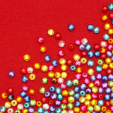Abstract Colorful beads on red Stock Photo