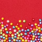 Abstract Colorful beads on red Royalty Free Stock Photos