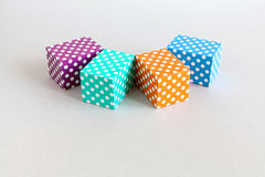 Abstract colorful blocks polka dot pattern. Violet green orange blue color rectangular boxes arranged on gray background Stock Image