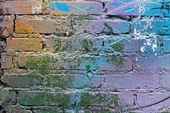 Abstract colorful blue, purple,orange, white and green painted brick wall Stock Photos