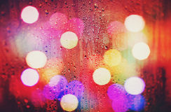 Abstract colorful blurred background. Drops of rain on glass Stock Photography