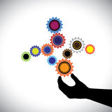 Abstract colorful cogwheels graphic  controlled by hand(person) Royalty Free Stock Image