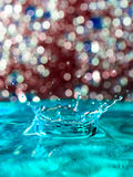 Abstract, colorful composition with small bokeh lights, water drops and water texture Royalty Free Stock Photos