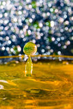 Abstract, colorful composition with small bokeh lights, water drops and water texture Stock Photo