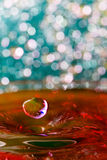 Abstract, colorful composition with small bokeh lights, water drops and water texture Stock Image
