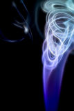 Curling smoke against black. Abstraction from curling incense smoke against black background Royalty Free Stock Photos