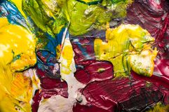 Abstract colorful dry acrylic paint. On plate Royalty Free Stock Photo