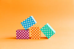 Abstract colorful geometric background vivid polka dots pattern cube boxes. Violet blue green rectangular block Stock Images