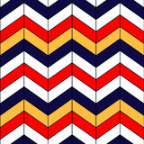 Abstract colorful geometric chevron seamless pattern in blue red yellow and white, vector. Background Stock Photos