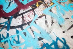 Abstract colorful graffiti fragment over old wall Royalty Free Stock Photo