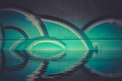 Abstract colorful graffiti reflection in the water, artistic chr Royalty Free Stock Photos