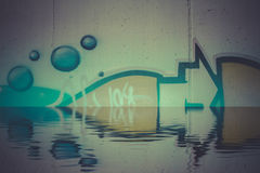 Abstract colorful graffiti reflection in the water Stock Photos