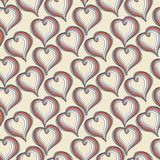 Abstract  colorful Hearts on a beige background Stock Photos