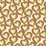 Abstract  colorful Hearts on a beige background Royalty Free Stock Images