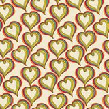 Abstract  colorful Hearts on a beige background Stock Photography