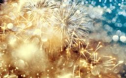 Abstract holiday background with fireworks. Abstract colorful holiday background of sky with fireworks and stars Stock Photo
