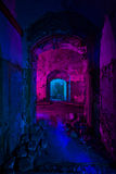 Abstract colorful light painting in abandoned soviet bunker. Pin. K and blue bright lights inside seedy arc Stock Photos