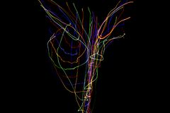 Abstract colorful lines on black background. Light painting photography with irregular patterns for overlay. Resource for stock illustration