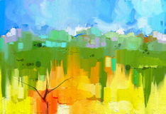 Abstract colorful oil painting landscape. On canvas. Semi- abstract image of tree in yellow and green field with blue sky.Spring season nature background Stock Image