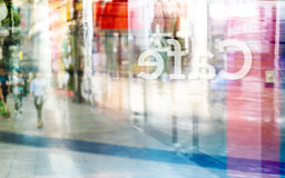 Abstract colorful and pastel people walk at front coffee shop and text cafe flip in back of mirror, soft and blur concept Royalty Free Stock Images