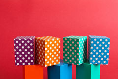 Abstract colorful polka dots pattern boxes on green orange blue blocks. Seamless design geometrical objects, red Stock Image