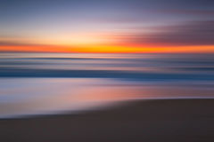 Abstract of a colorful seascape at sunrise Stock Image