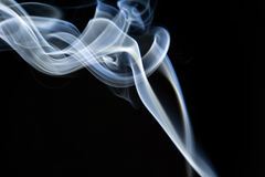 Abstract colorful smoke background. Colorful smoke curls isolated on black Stock Photos