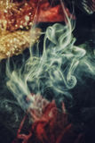 Abstract colorful smoke on a black background Stock Photography