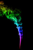 Abstract colorful smoke on black background Stock Images