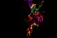 Abstract colorful smoke on the black background Stock Photography