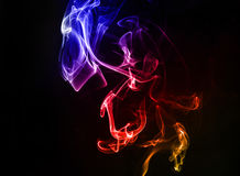 Abstract colorful smoke on the black background Royalty Free Stock Image