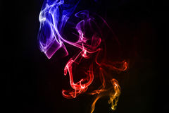 Abstract colorful smoke on the black background Stock Photo