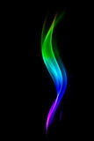 Abstract colorful smoke isolated on black background. Royalty Free Stock Photography