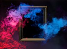 Colorful smoke from wooden frame Royalty Free Stock Photos