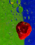 Abstract colorful strawberry. In water with many bubbles Stock Photos