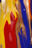 Abstract colorful wet paint. Abstract composition of wet paints mixed with copper. Yellow, red and blue colours Royalty Free Stock Images