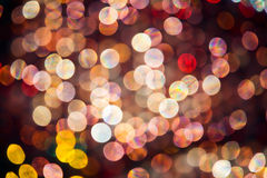 Abstract colourful highlights. Abstract pink, red and yellow oval shaped highlights which are out of focus backlit glass spheres Royalty Free Stock Image