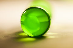 Abstract composition with beautiful, green, round jelly balls on an aluminium foil with reflexions Stock Photos