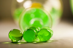 Abstract composition with beautiful, green, transparent, round jelly balls on an aluminium foil with reflexions Royalty Free Stock Photo