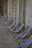 Abstract composition of blue and white deckchairs. Royalty Free Stock Image