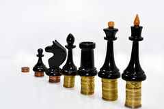 Abstract composition of chess and money. Stock Photo