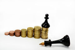 Abstract composition of chess and money. Royalty Free Stock Photos