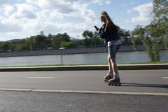 MOSCOW, RUSSIA - 06.20.2018: Yong girl in Gorky Park moving on h royalty free stock photos
