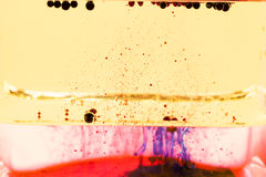 Abstract composition with mix of oil, water and colorful ink Royalty Free Stock Images
