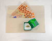 Abstract composition - money in the envelope for buying jewelry Stock Image