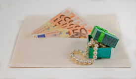 Abstract composition - money in the envelope for buying jewelry Royalty Free Stock Photography